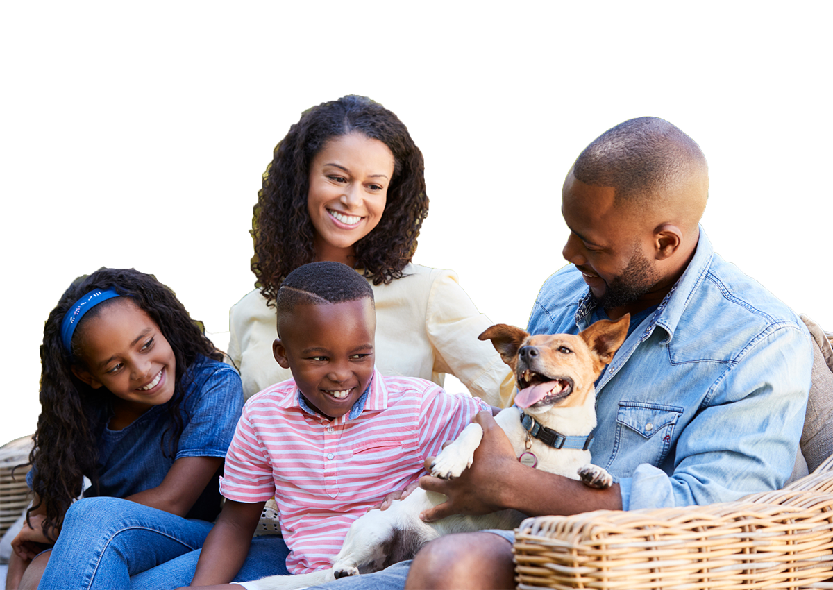 Smiling Family with Mother, Father, Two Adolescent Children and Small Dog
